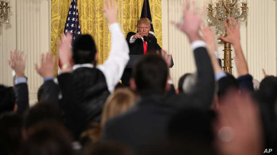 President Donald Trump calls on a reporter during a news conference in the East Room of the White House in Washington, Feb. 16, 2017.