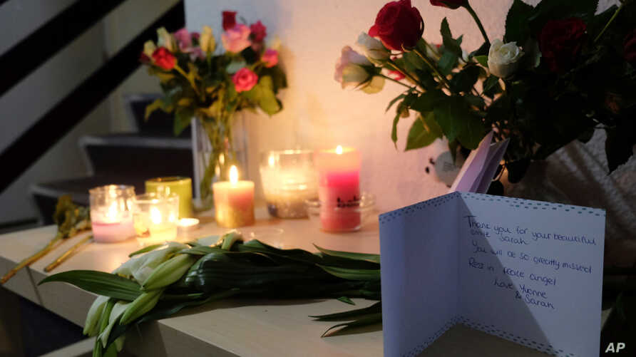 Tributes are placed on a table in an apartment block in Rotterdam, Netherlands, on Dec. 14, 2018, where American student Sarah Papenheim lived. Papenheim, a 21-year-old psychology student at Erasmus University, was fatally stabbed at her home on Wedn