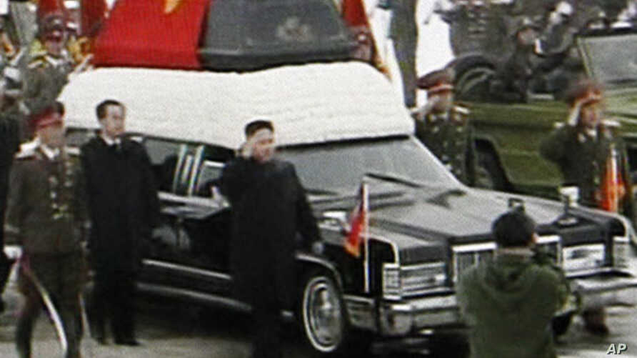 TV image made from KRT video shows Kim Jong Un, Kim Jong Il's youngest son and successor as he walks next to his father's hearse during a funeral procession for the late North Korean leader in Pyongyang, December 28, 2011.
