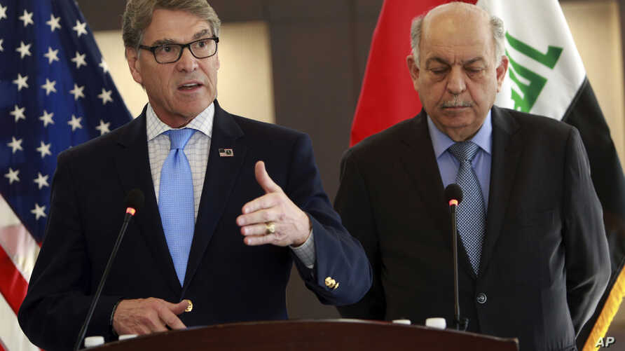 U.S. Energy Secretary Rick Perry, left, is seen with Iraqi oil minister, Thamir Ghadhban, during a U.S. Chamber of Commerce U.S.-Iraq business initiative mission to Iraq, in Baghdad, Dec. 11, 2018.