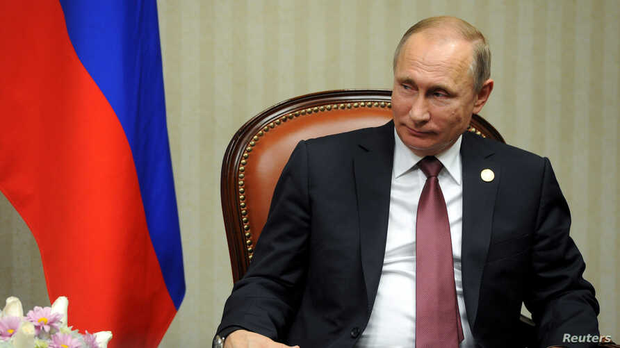 Russian President Vladimir Putin attends a meeting at the Asia-Pacific Economic Cooperation Summit in Lima, Peru, Nov. 19, 2016.  In remarks made as part of a documentary film produced by American filmmaker Oliver Stone, Putin suggest Russia's annexa