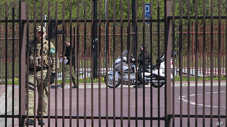 A Russian biker is seen stopped at the border between Belarus and Poland, in Terespol, Poland, April 27, 2015.