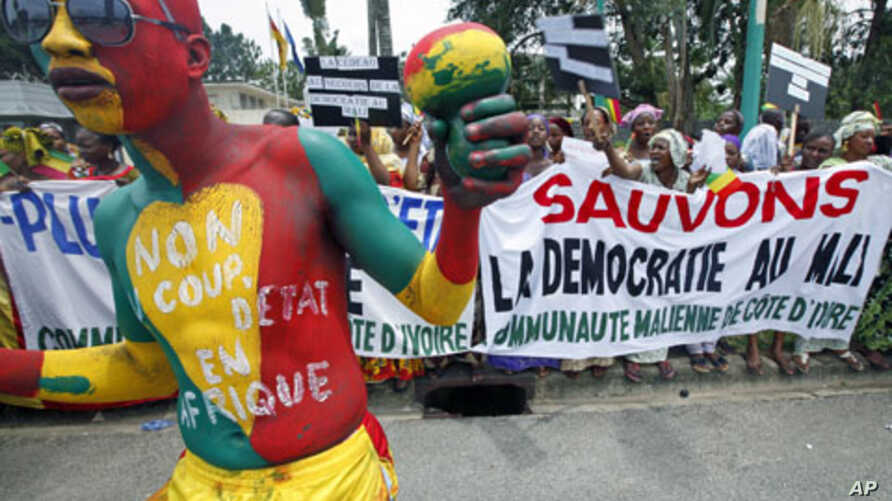 Malians living in Ivory Coast protest against a coup in their country, during the Extraordinary Meeting of ECOWAS, in Abidjan, March 27, 2012.