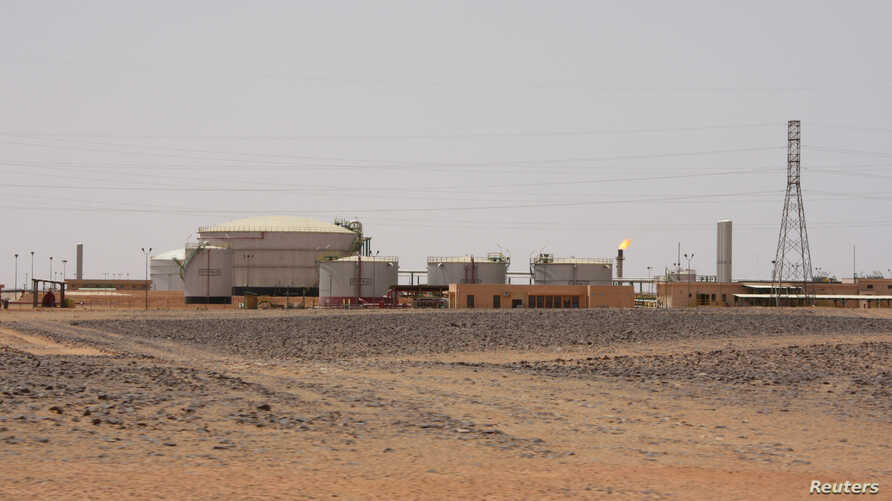 FILE - A view of the El Feel oilfield near Murzuq, Libya, July 6, 2017.