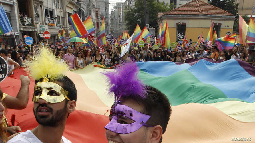 Participants wave a huge rainbow flag during a gay pride parade in Istanbul, June 30, 2013. Tens of thousands of anti-government protesters teamed up with a planned gay pride march in Istanbul.