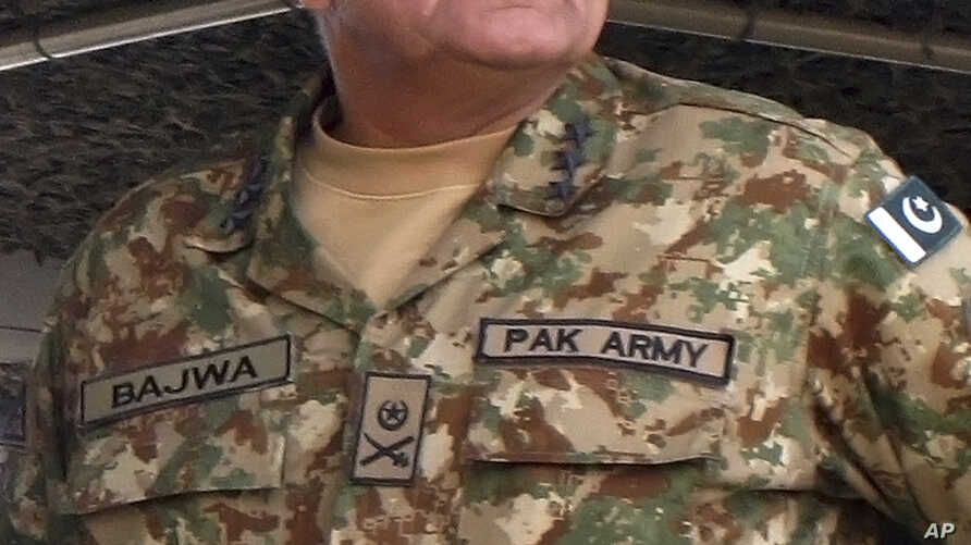 In this Wednesday, Nov. 16, 2016 photo, Pakistan's army senior officer Lt. Gen. Qamar Javed Bajwa attends a military exercise in Khairpur Tamiwali, Pakistan.