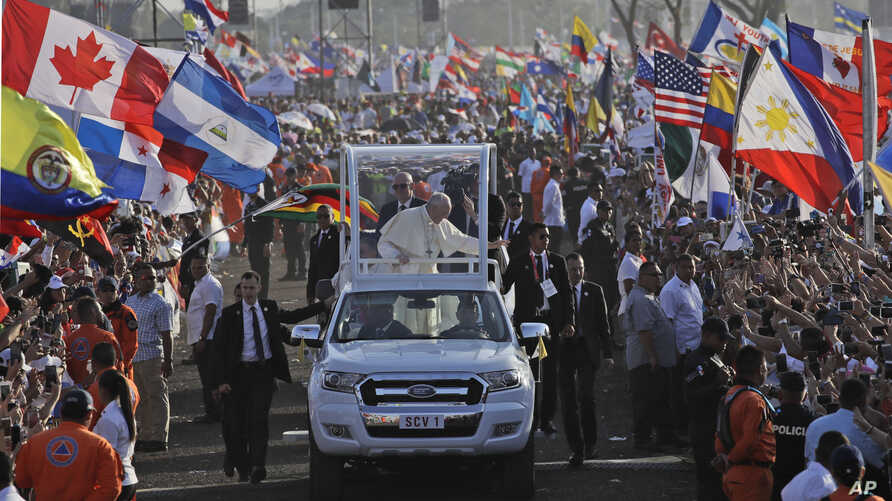 Pope Francis waves from his popemobile as he arrives to celebrate an early morning Mass at the metro park Campo San Juan Pablo II in Panama City, Jan. 27, 2019.