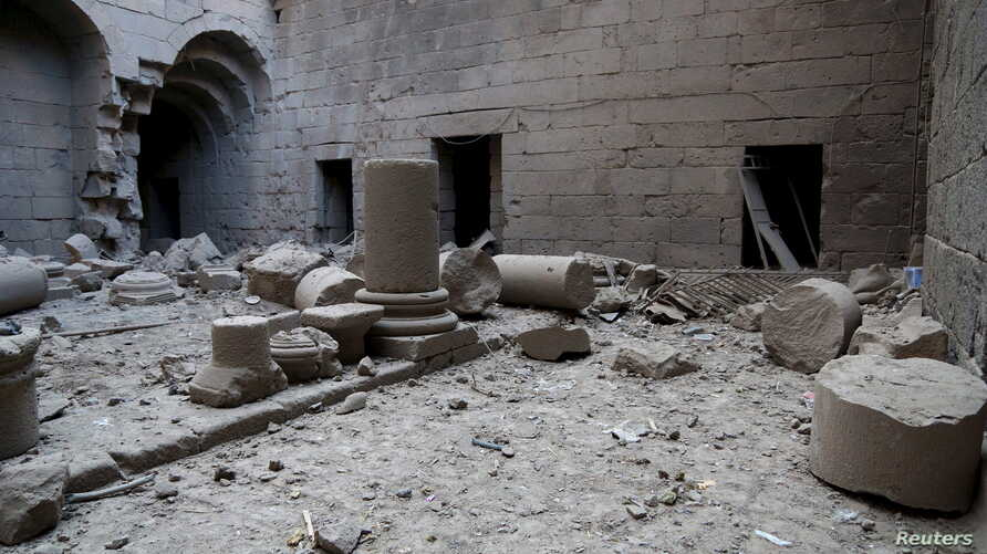 """Damaged pillars lie on the ground in Sahat al-Mumathileen (Arabic for the """"Yard of Actors""""), a square in the western part of Bosra's ancient citadel, after what activists said was an airstrike by forces loyal to Syria's president Bashar al-Assad in t"""
