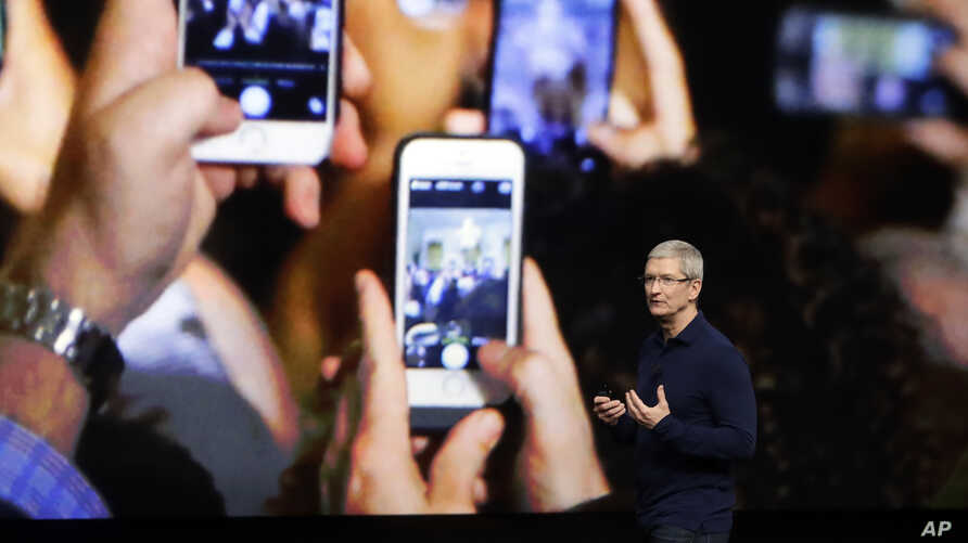 FILE - Apple CEO Tim Cook announces the new iPhone 7 during an event to announce new products, in San Francisco.