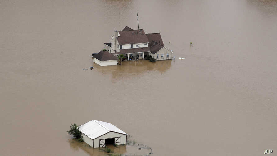 A home surrounded by floodwaters in Rosharon, Texas, June 4, 2016, .