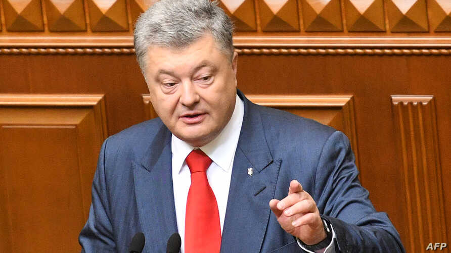 Ukrainian President Petro Poroshenko addresses lawmakers in Ukraine's Parliament in Kyiv, Ukraine, Sept. 20, 2018.