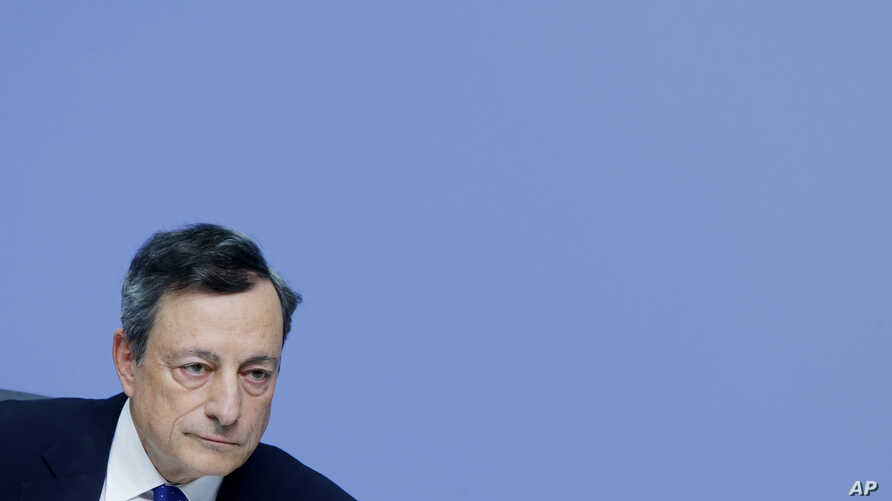 President of European Central Bank, Mario Draghi, listens during a news conference in Frankfurt, Germany, Dec. 8, 2016, following a meeting of the ECB governing council.