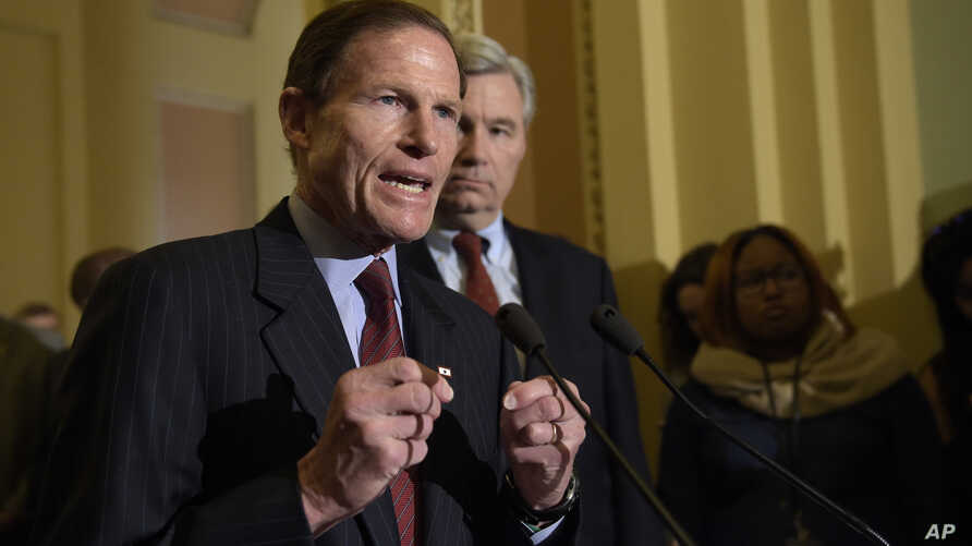 Sen. Richard Blumenthal, D-Conn., accompanied by Sen. Sheldon Whitehouse, D-R.I., speaks to reporters during a news conference on Capitol Hill in Washington, Feb. 7, 2017.