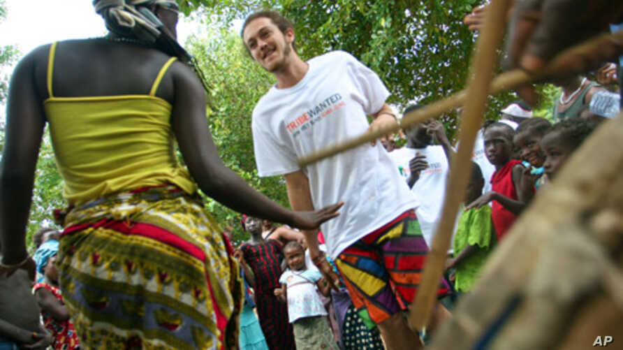 Tribe members and locals dance together at the launch of