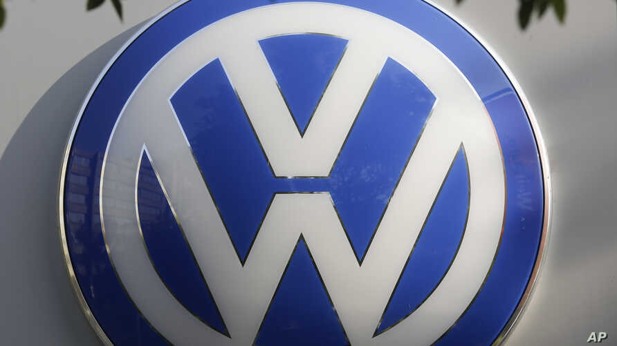 The VW sign of Germany's car company Volkswagen is displayed at the building of a compsny's retailer in, Berlin, Germany, Oct. 5, 2015.