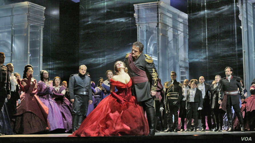 Enraged by Iago's lies about Desdemona's faithfulness, Otello (Aleksandrs Antonenko) loses control and insults her in front of the Venetian court.