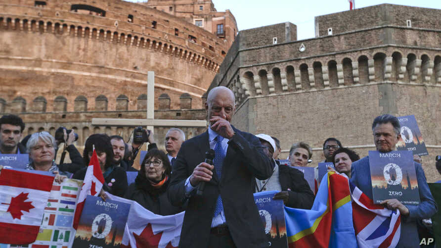 FILE - Sex-abuse survivor Peter Isely of the U.S.-founded Ending Clergy Abuse organization, speaks during a twilight vigil prayer near Castle Sant' Angelo, in Rome, Feb. 21, 2019.