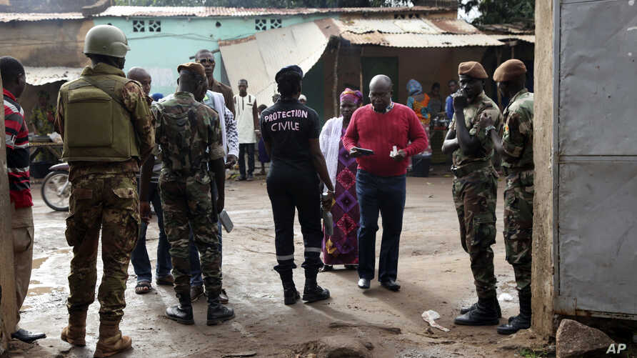 Security officers stand guard in front of a polling station during presidential elections, in Bamako, Mali, July 29, 2018.