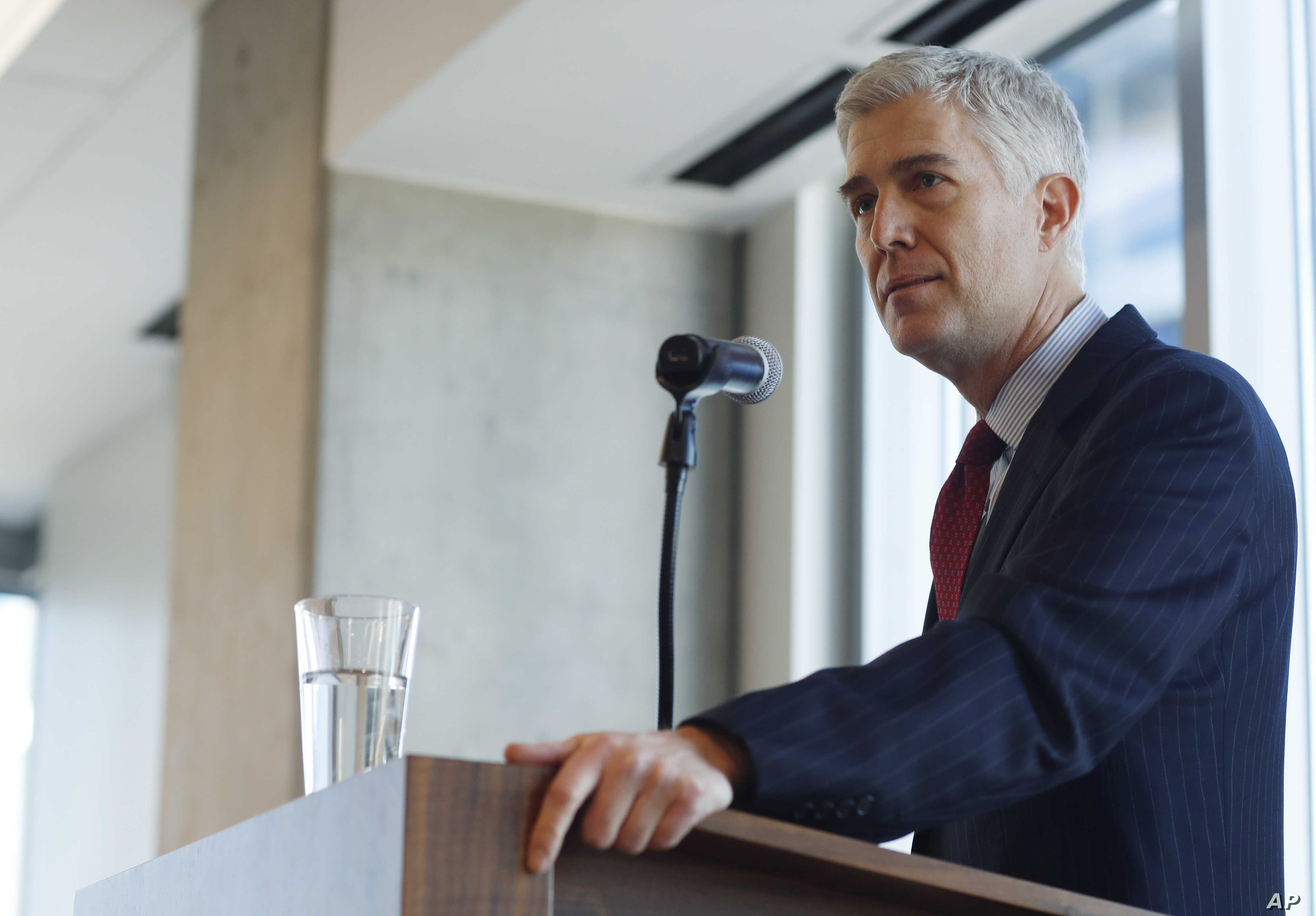 FILE - 10th U.S. Circuit Court of Appeals Judge Neil Gorsuch makes a point while delivering prepared remarks before a group of attorneys at a luncheon in a legal firm in lower downtown Denver, Jan. 27, 2017.