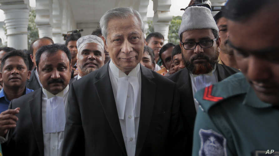 FILE - Bangladesh's Attorney General Mahbubey Alam, center, leaves court after the death sentences given to two opposition leaders for 1971 war crimes was upheld in Dhaka, Bangladesh, Nov. 18, 2015.