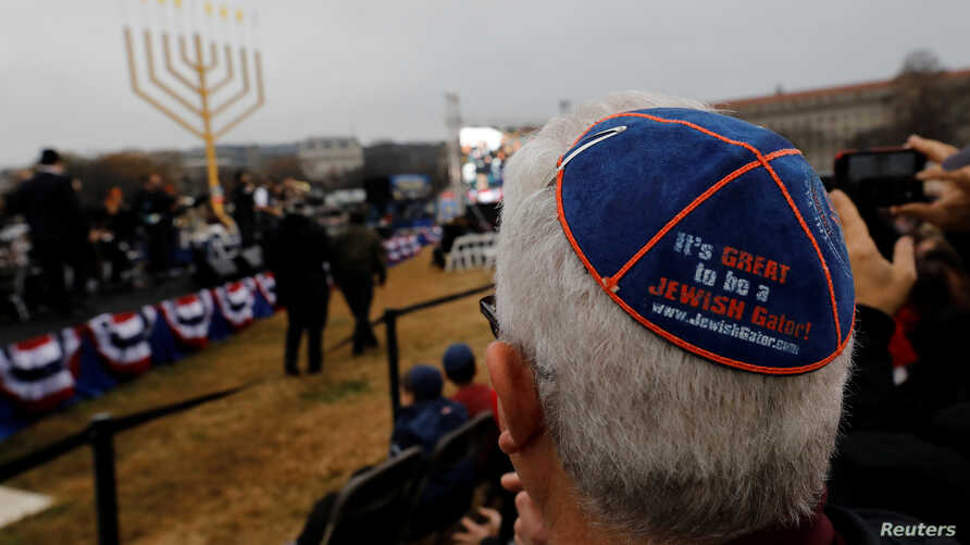 Guests gather for the National Menorah lighting ceremony to mark the start of Hanukkah on the Ellipse near the White House in Washington, Dec. 2, 2018.