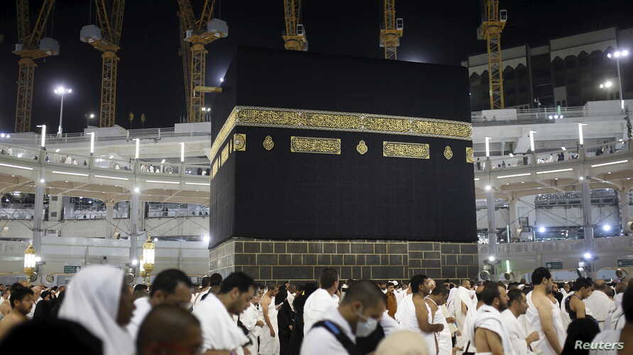 Muslim pilgrims pray around the holy Kaaba at the Grand Mosque on the first day of Eid al-Adha during the annual hajj pilgrimage in Mecca, Sept. 24, 2015.