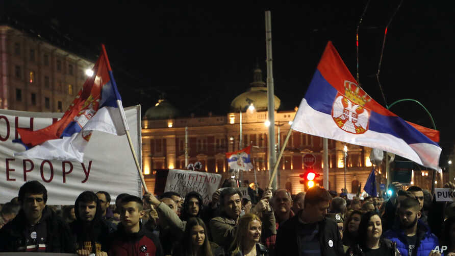 People march during a protest in Belgrade, Serbia, March 16, 2019. Thousands of people rallied in Serbia's capital for 15th week in a row against populist President Aleksandar Vucic and his government.