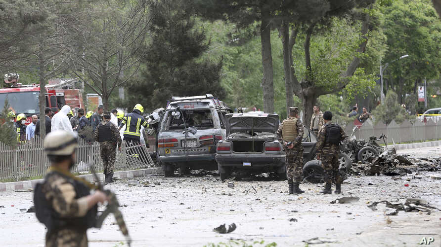 Security forces inspect at the site of a suicide attack in Kabul, Afghanistan,  May 3 , 2017.