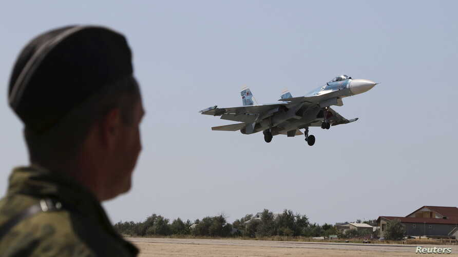 FILE - A Russian SU-33 naval fighter plane flies during a drill at the Nitka training complex in the village of Novofedorovka, west of the Crimean city of Simferopol, Aug. 27, 2015.