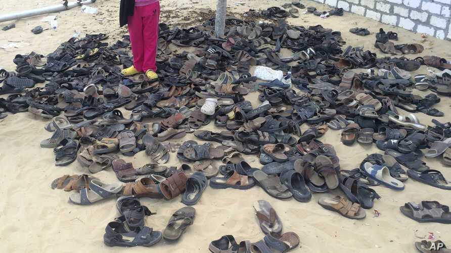 Discarded shoes of victims remain outside al-Rawdah mosque in Bir al-Abed, northern Sinai, Egypt, a day after attackers killed hundreds of worshippers, Nov. 25, 2017.