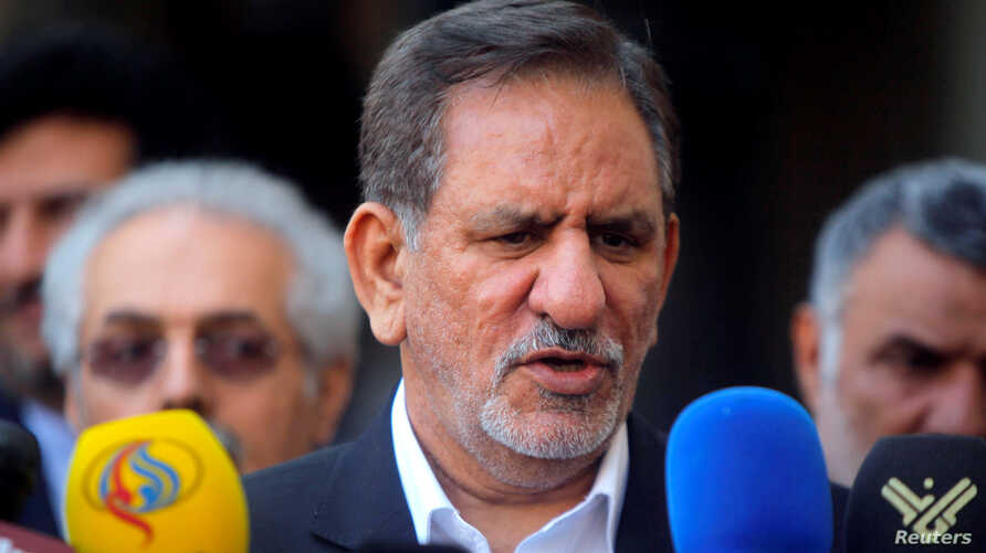 FILE - Iranian Vice President Eshaq Jahangiri speaks during a news conference, in Najaf, south of Baghdad, Feb. 18, 2015. Jahangiri said Sunday that Iran will allow private companies to export crude oil in an attempt to defeat U.S. sanctions.