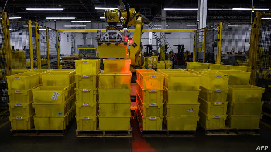 A robot organizes containers at the 855,000-square-foot Amazon fulfillment center in Staten Island, one of the five boroughs of New York City, Feb. 5, 2019.