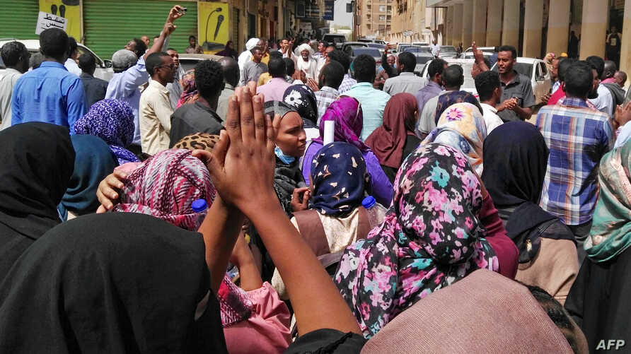 Sudanese protesters take part in an anti-government demonstration in Khartoum, Feb. 14, 2019. Deadly protests that erupted in Sudan Dec. 19 over the tripling of the price of bread have spread across the country and escalated into calls for President