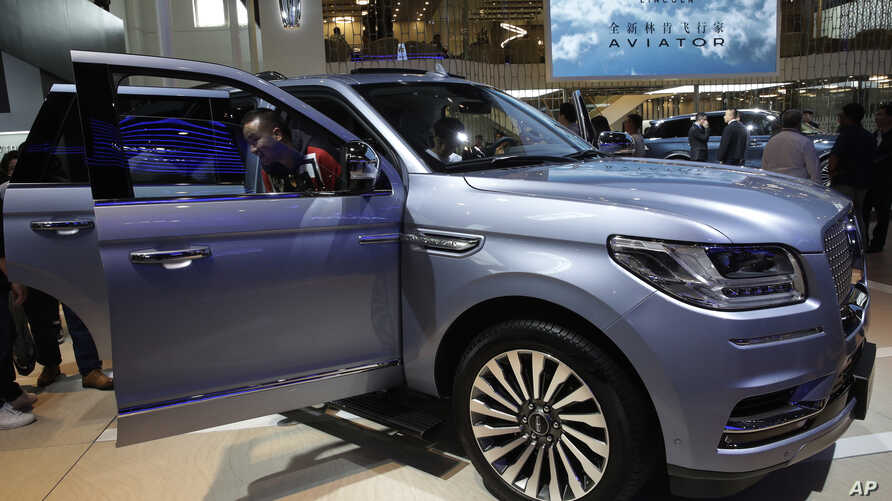 FILE - A man steps out from a Lincoln Navigator SUV on display at the China Auto Show in Beijing, April 25, 2018. Used, once-leased Lincoln vehicles are among the cars available as subscriptions in San Francisco.