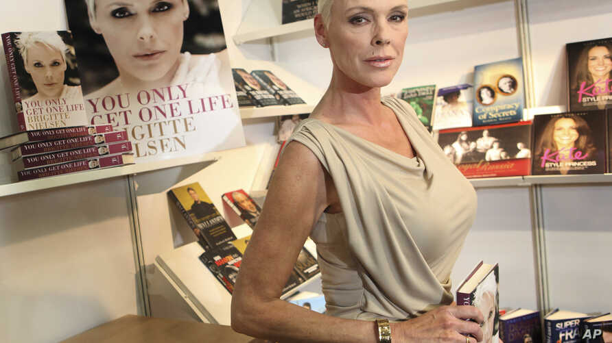 """FILE - Actress Brigitte Nielsen launches her autobiography, """"You Only Get One Life"""", at the London Book Fair, Earl's Court Exhibition Centre, London, April 11, 2011."""