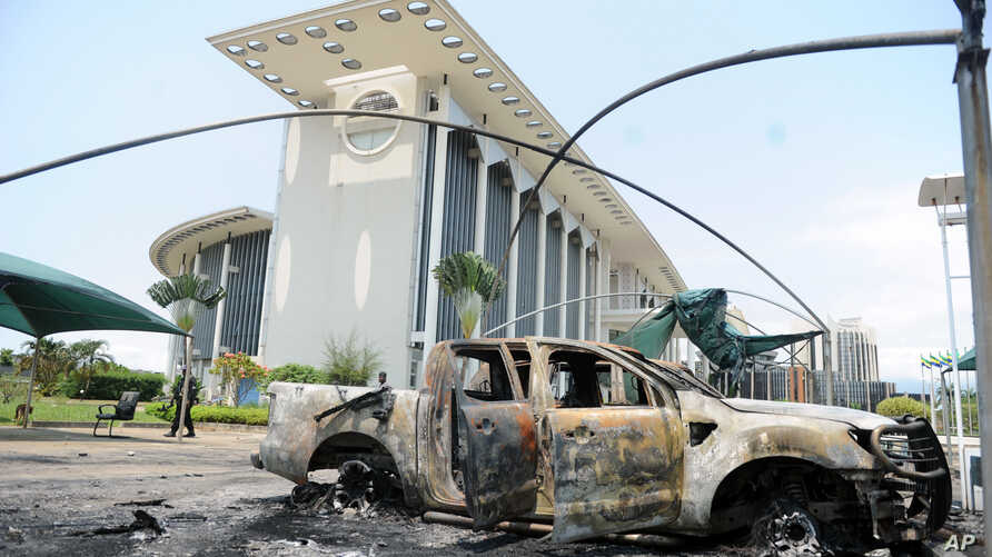 Burnt out cars are seen outside a government building, following an election protest in Libreville, Gabon, Sept. 1, 2016.