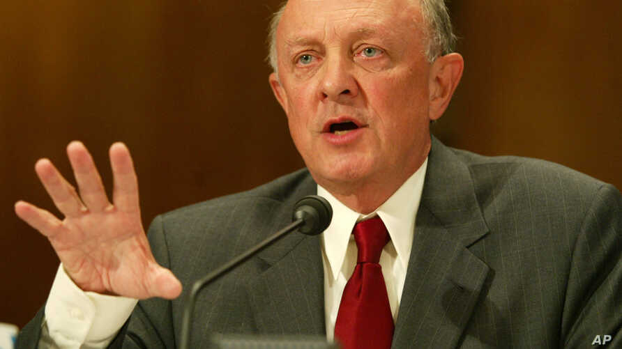 FILE - Former CIA director James Woolsey testifies on Capitol Hill, Aug. 16, 2004, in Washington.