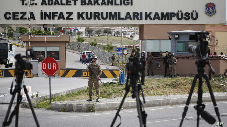 Cameras of members of the media are placed across from the prison complex in Aliaga, Izmir province, western Turkey, where jailed pastor Andrew Craig Brunson appeared on his trial at a court inside the complex, April 16, 2018.