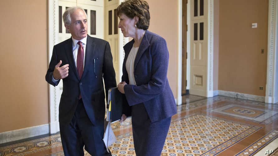 Senate Foreign Relations Committee Chairman Sen. Bob Corker, R-Tenn., Sen. Susan Collins, R-Maine, a member of the Intelligence Committee, confer outside the Senate chamber on Capitol Hill in Washington, as GOP leaders in Congress are calling for a p
