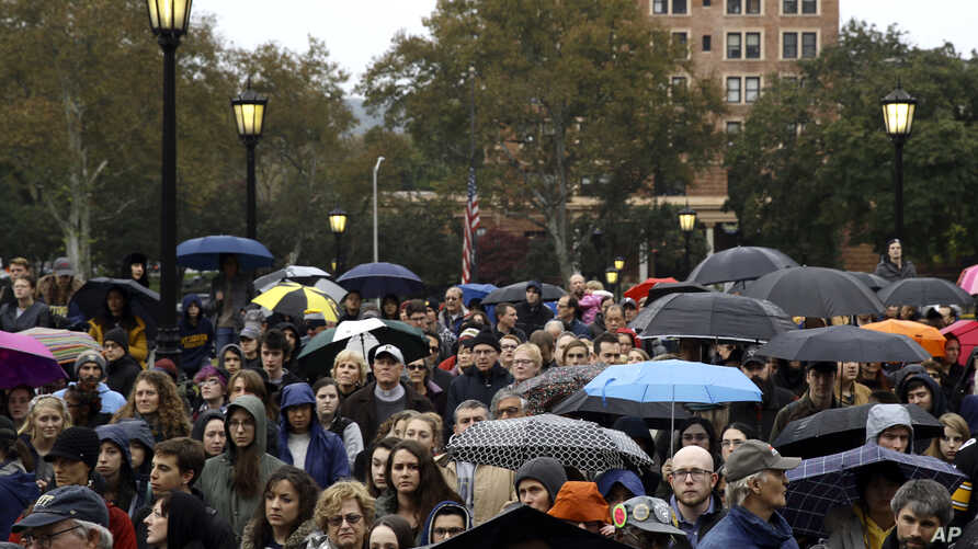 People stand outside the Soldiers & Sailors Memorial Hall & Museum due to over-capacity at a community gathering inside, Sunday, Oct. 28, 2018, in Pittsburgh, in the aftermath of the deadly shooting at the Tree of Life Synagogue a day earlier.