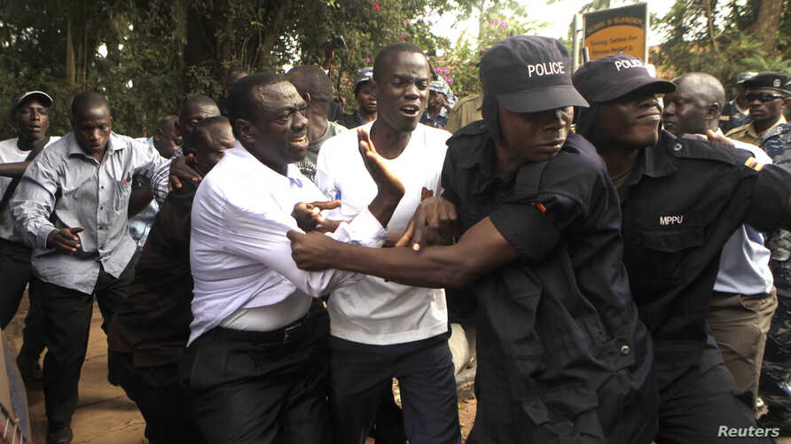 Ugandan police arrested opposition leader Kizza Besigye and supporters before the start of a political rally in July, 2012 in the capital, Kampala.