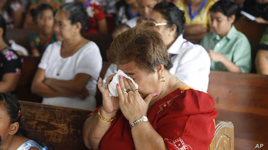 FILE - Samoans attend church services at Holy Cross Catholic Church in Leone, American Samoa, Oct. 4, 2009. Many women in Samoa have experienced violence, according to a 2007 study.