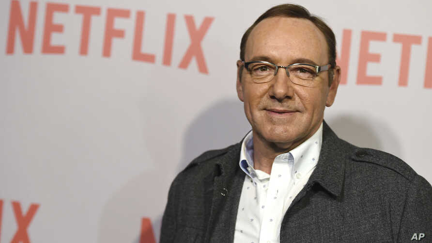 "FILE - Kevin Spacey arrives at the Samuel Goldwyn Theater in Beverly Hills, Calif., April 27, 2015. Netflix says Spacey is out at ""House of Cards"" after a series of allegations of sexual harassment and assault and it is cutting all ties with Spacey."