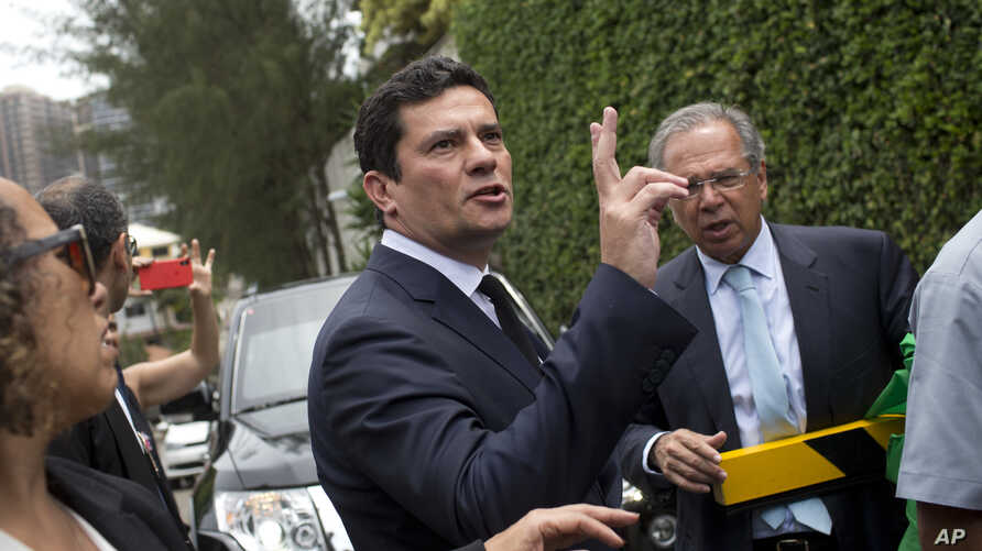 Judge Sergio Moro talks to the press as he exits a meeting with President-elect Jair Bolsonaro, outside Bolsonaro's home in Rio de Janeiro, Brazil, Nov. 1, 2018.