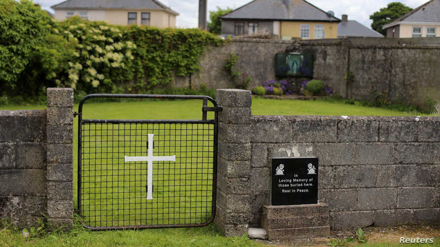 FILE - The entrance to the site of a mass grave of hundreds of children who died in the former Bons Secours home for unmarried mothers is seen in Tuam, County Galway, Ireland, June 4, 2014.