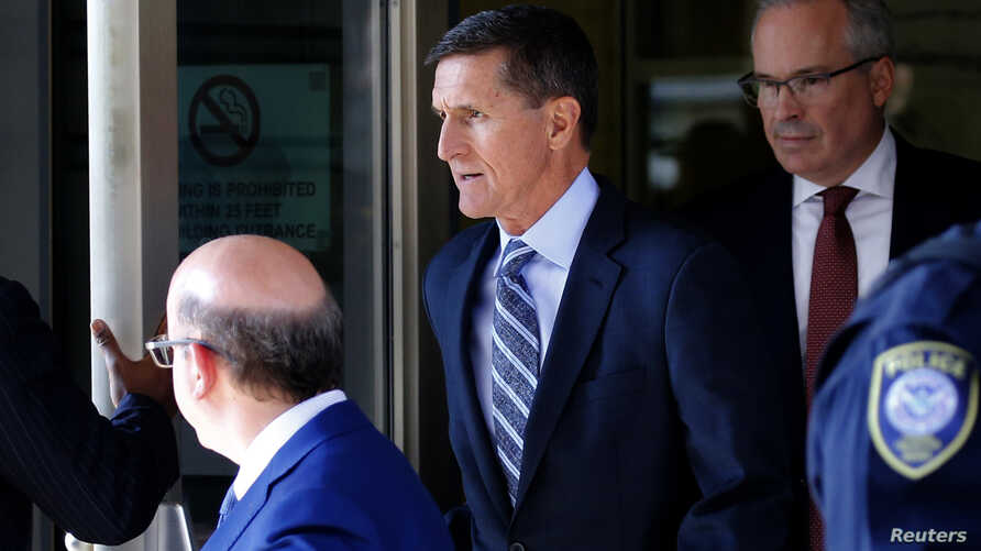 Former U.S. National Security Adviser Michael Flynn departs U.S. District Court, where pleaded guilty to lying to the FBI about his contacts with Russia's ambassador to the United States, in Washington, Dec. 1, 2017.