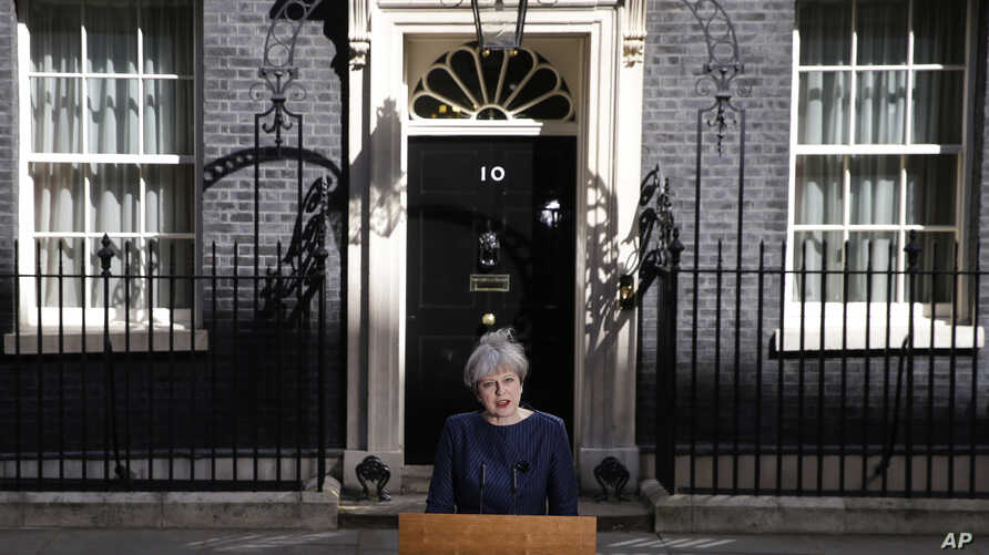 Britain's Prime Minister Theresa May speaks to the media outside her official residence of 10 Downing Street in London, April 18, 2017.