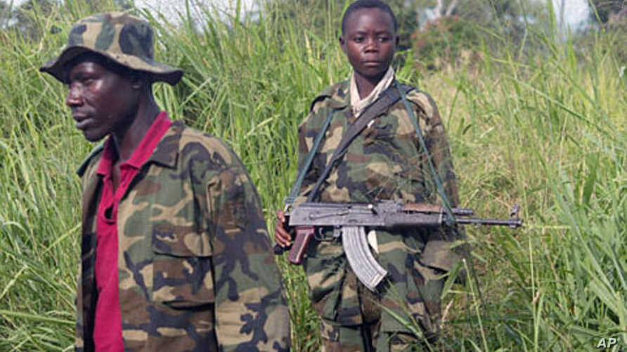 Fighters of the rebel Union of Congolese Patriots, one of them a child soldier, man a checkpoint, on the outskirts of Bunia, Congo, (File)