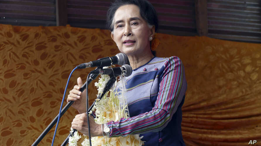 """Myanmar opposition leader Aung San Suu Kyi speaks during her """"Election Awareness Tour"""" in Ho-Pong township in Pa-O self-administrative zone, southern Shan State, Myanmar, Sunday, Sept. 6 2015."""