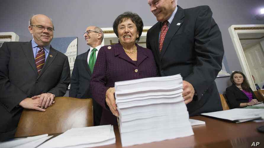 House Rules Committee Chairman Pete Sessions, R-Texas, right, welcomes Rep. Nita Lowey, D-N.Y., ranking member of the Appropriations Committee, and Rules Committee member Rep. James P. McGovern, D-Mass., as they gather at the Capitol around a printou